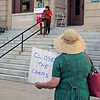 CAMDEN CHAFFEE | THE GOSHEN NEWS<br /> Protest signs were carried by many people who attended the lights 4 liberty rally Friday night at the county courthouse in Goshen.