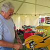 CAMDEN CHAFFEE | THE GOSHEN NEWS<br /> Mark Klingler, from Youngstown Ohio, works on his Piper - J3 Cub model airplane Thursday at the Air Supremacy Over Goshen at the Goshen Municipal Airport.