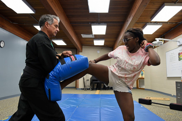 BEN MIKESELL   THE GOSHEN NEWS<br /> Seventh-grader Dapchar Lehman tries a side kick with instructor Steve Thomas from Peacemakers Academy during Bright Time Summer Camp week Thursday at Bethany Christian Schools.