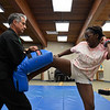 BEN MIKESELL | THE GOSHEN NEWS<br /> Seventh-grader Dapchar Lehman tries a side kick with instructor Steve Thomas from Peacemakers Academy during Bright Time Summer Camp week Thursday at Bethany Christian Schools.