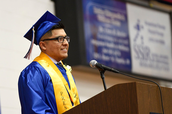 BEN MIKESELL | THE GOSHEN NEWS<br /> Senior class president Isai Lopez addresses his classmates during Sunday's graduation ceremony at West Noble High School.