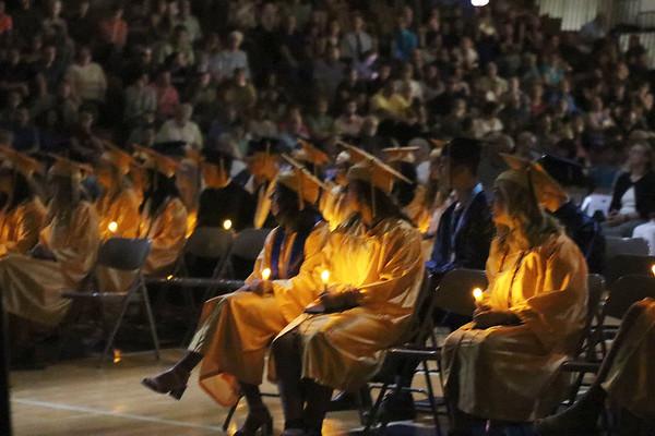 SHEILA SELMAN | THE GOSHEN NEWS<br /> Fairfield High School graduates hold candles as the choir sings toward the end of Sunday's graduation ceremony.