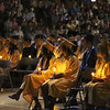 SHEILA SELMAN | THE GOSHEN NEWS<br /> Fairfield High School graduates hold candles as the choir sings toward the end of Sunday's graduation ceremony.