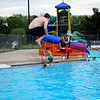AIMEE AMBROSE | THE GOSHEN NEWS <br /> Wes Rush, a NorthWood High School student, watches children jump off a diving board as he works as a lifeguard at Shanklin Pool in Goshen.