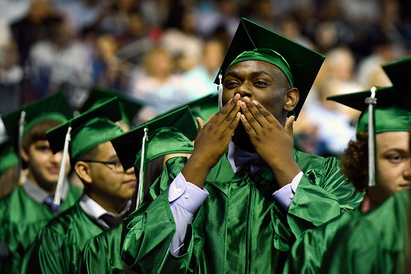 BEN MIKESELL | THE GOSHEN NEWS<br /> Senior Shontell Coprich blows a kiss to the crowd as he walks with classmates during Concord's graduation  commencement Thursday at the Purcell Pavilion in South Bend.