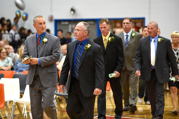 BEN MIKESELL   THE GOSHEN NEWS<br /> West Noble administration staff walk down the aisle to the stage as the 2019 graduation commencement begins Sunday at West Noble High School.