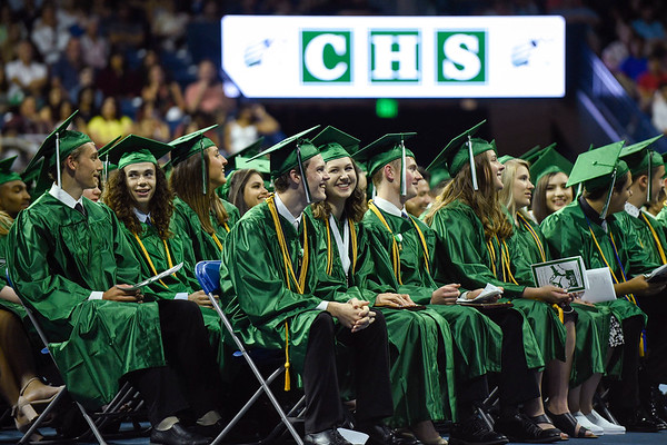 BEN MIKESELL | THE GOSHEN NEWS<br /> The class of 2019 laughs at a joke from faculty speaker Joe Wharton during Concord's graduation commencement Thursday at the Purcell Pavilion in South Bend.