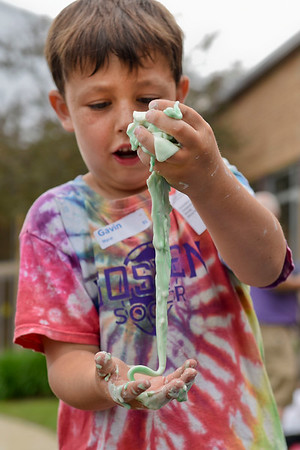 BEN MIKESELL   THE GOSHEN NEWS<br /> Parkside second-grader Gavin Nyce holds oobleck slime, made of cornstarch and water, in his hands during Bright Time Summer Camp week at Bethany Christian Schools. Students at the messy week station got their hands dirty with slimes and paper mache creations.