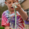 BEN MIKESELL | THE GOSHEN NEWS<br /> Parkside second-grader Gavin Nyce holds oobleck slime, made of cornstarch and water, in his hands during Bright Time Summer Camp week at Bethany Christian Schools. Students at the messy week station got their hands dirty with slimes and paper mache creations.