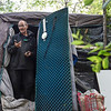 BEN MIKESELL | THE GOSHEN NEWS<br /> Scott Shank, of Goshen, cleans out his tent near the Millrace Powerhouse early Monday morning in Goshen. City officials gave the remaining residents of the tent city a 48-hour notice to move out.