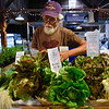 BEN MIKESELL | THE GOSHEN NEWS<br /> Dale Hasenick, of Marcellus, Michigan, spruces up his display of vegetables from his farm, White Yarrow Farm, Saturday at the Goshen Farmer's Market. Hasenick and his wife Jo Beachy have had a table at the market since it began in 2000.