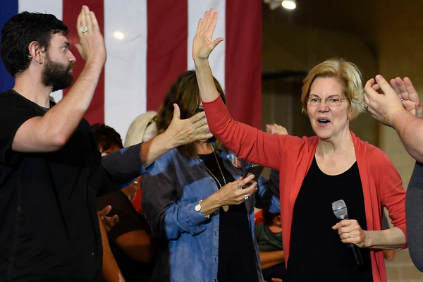 BEN MIKESELL | THE GOSHEN NEWS<br /> Senator and democratic presidential candidate Elizabeth Warren greets the audience as she steps onto the stage during a campaign event Wednesday morning at the Northern Indiana Event Center.