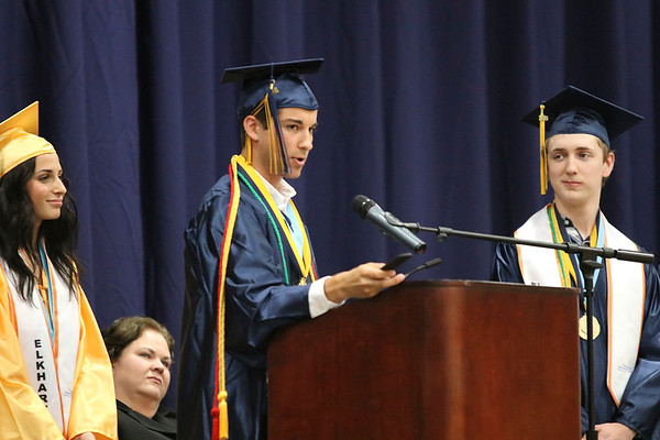 SHEILA SELMAN | THE GOSHEN NEWS<br /> In his commencement address, Drew Martin waves around a paddle while talking about life's realities Sunday at Fairfield Jr.-Sr. High School.