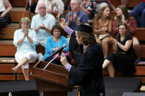 KORY STONEBURNER-BETTS | THE GOSHEN NEWS<br /> NorthWood High School senior Luke Lingle ends his speech with a Rubick's cube raised in the air.