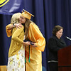 SHEILA SELMAN | THE GOSHEN NEWS<br /> Olivia Elledge hugs her mom, Fairfield School Board member Sarah Elledge, on stage after her mom handed her a diploma Sunday afternoon.