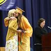 SHEILA SELMAN | THE GOSHEN NEWS<br /> Olivia Elledge hugs her mom, Fairfield School Board member Sarah Elledge, on stage after her mom handed her a diploma Sunday afternoon.