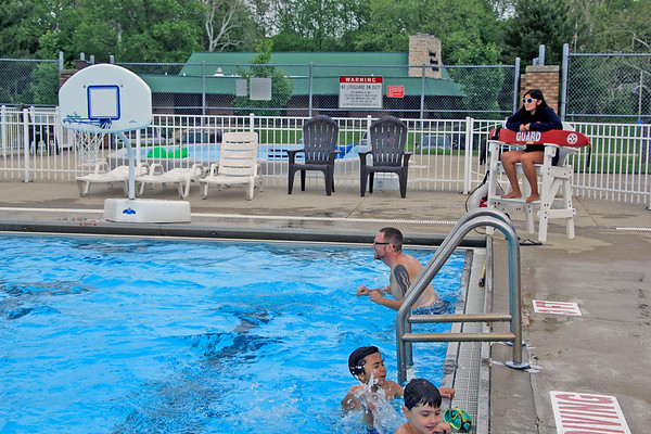 AIMEE AMBROSE | THE GOSHEN NEWS <br /> Carolina Olivo, a Goshen High School student, sits at her station and monitors swimming children and families in her role as a lifeguard at Shanklin Pool in Goshen.