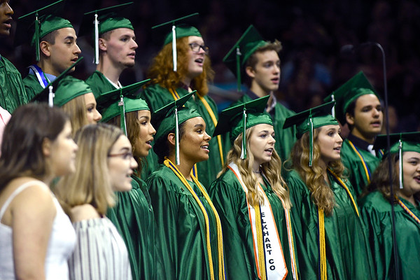 BEN MIKESELL | THE GOSHEN NEWS<br /> Senior choir members open Concord's graduation ceremony in song Thursday at the Purcell Pavilion in South Bend.
