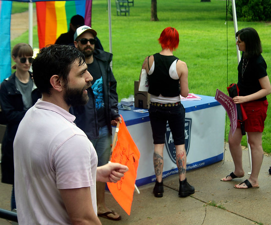SHEILA SELMAN | THE GOSHEN NEWS<br /> Abortion rights rally organizer Aaron Mishler speaks to the group assembled at the Elkhart County Courthouse steps Saturday evening.