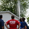 BEN MIKESELL | THE GOSHEN NEWS<br /> Millersburg-Clinton firefighters attempt to scare Cheeto to a more accesible tree during a rescue attempt Tuesday afternoon in Millersburg.