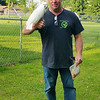 ANGIE KULCZAR | THE GOSHEN NEWS<br /> Cheeto the cockatoo perches on owner Scott Reinhart's arm after being lured down with a bag of nuts Tuesday evening in Millersburg.