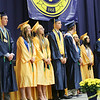 SHEILA SELMAN | THE GOSHEN NEWS<br /> Fairfield's top 10 seniors each spoke during commencement. At the podium is Clayton Thomas. From left are Matt Parson, Brian Troyer, Kaitlyn Reese, Nicole Miller, Aaron Streit, Michael Heckman, Lydia Holsopple and Kylie Miller. Outside the frame is Drew Martin.
