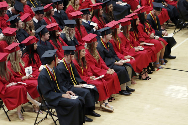 KORY STONEBURNER-BETTS | THE GOSHEN NEWS<br /> NorthWood High School graduates look on while being addressed by Principal David Maugel Friday night at NorthWood High School.