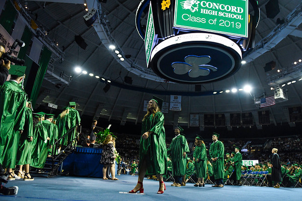 BEN MIKESELL | THE GOSHEN NEWS<br /> Concord High School graduates make their way to the stage to receive their diplomas Thursday at Purcell Pavilion in South Bend.