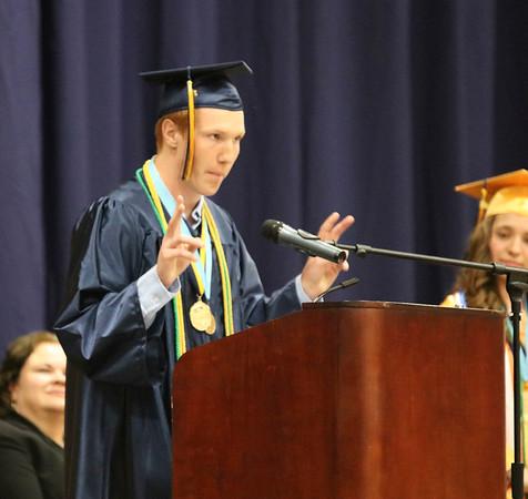 SHEILA SELMAN | THE GOSHEN NEWS<br /> Brian Troyer speaks during Fairfield High School graduation Sunday afternoon.