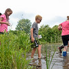 BEN MIKESELL | THE GOSHEN NEWS<br /> Second- and third-graders go on a walk through the muck Thursday afternoon during Bright Time summer camp at Bethany Christian Schools.