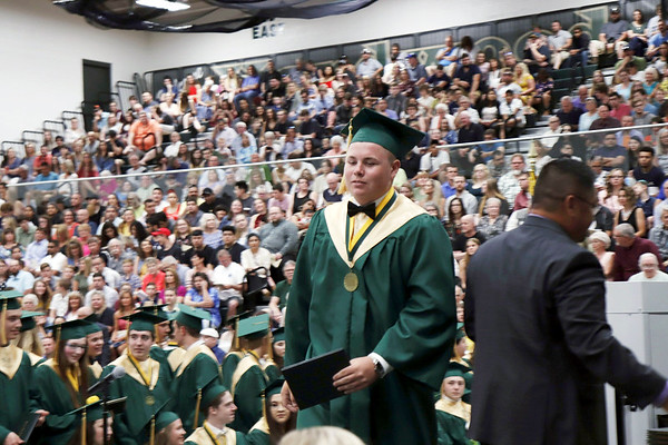 KORY STONEBURNER-BETTS | THE GOSHEN NEWS<br /> Dillon Drake accepts his diploma during Wawasee High School graduation ceremonies Sunday afternoon.