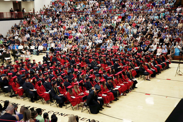 KORY STONEBURNER-BETTS | THE GOSHEN NEWS<br /> NorthWood High School students assemble for commencement Friday night at the school gym while their families and friends look on.
