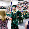 KORY STONEBURNER-BETTS | THE GOSHEN NEWS<br /> Gaven M. Cole is congratulated on receiving his high school diploma from Wawasee Sunday afternoon.