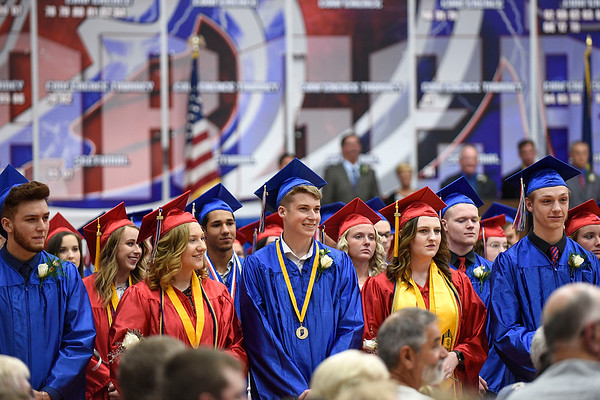 BEN MIKESELL | THE GOSHEN NEWS<br /> West Noble seniors stand and watch classmates walk down the aisle during Sunday's graduation ceremony at West Noble.