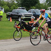 JOHN KLINE | THE GOSHEN NEWS<br /> Cyclists head out from the Elkhart County 4-H Fairgrounds early Saturday morning for the kickoff of the 20th annual Pumpkinvine Bike Ride and fundraiser.