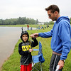 SHEILA SELMAN | THE GOSHEN NEWS<br /> Bennett Brown and dad Eric Brown, Goshen, display a small bluegill at Goshen Parks & Recreation Department's annual Fantastic Fishing Derby Saturday at Fidler Pond. Brown won the prize for first catch of the day.