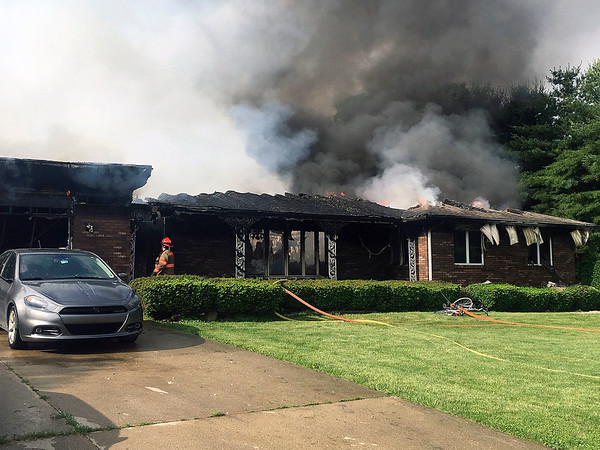 Ben Mikesell | The Goshen News<br /> New Paris, Turkey Creek and Benton fire departments are fighting Millersburg Clinton Fire Territory. Whole house roof is gone