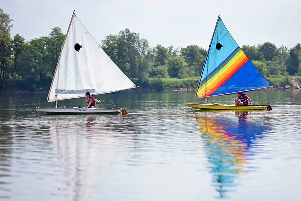 BEN MIKESELL | THE GOSHEN NEWS<br /> Sailing campers drift along on the calm water Tuesday morning at Fidler Pond Park in Goshen.