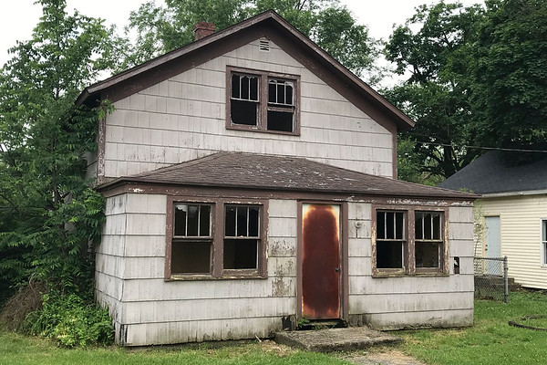 JOHN KLINE | THE GOSHEN NEWS<br /> This vacant home at 414 River Ave., Goshen, was deemed unsafe for human habitation and targeted for demolition during the Goshen Board of Public Works and Safety meeting Monday afternoon.