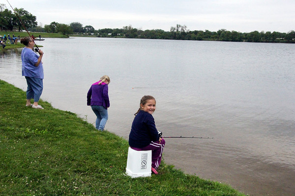 SHEILA SELMAN | THE GOSHEN NEWS<br /> Grace Keene, in front, and Faith Keene try to hook a few fish during the Goshen Parks & Recreation Department's Fantastic Fishing Derby Saturday.