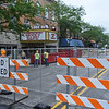 BEN MIKESELL | THE GOSHEN NEWS<br /> A construction crew works outside of the Goshen Theater Monday morning in downtown Goshen. Main Street, bewteen Jefferson and Washington Streets, will be closed this week as renovations continues.