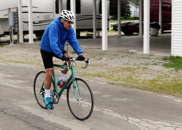 JOHN KLINE | THE GOSHEN NEWS<br /> Tim Strnad, of Sterling Heights, Michigan, heads out from the Elkhart County 4-H Fairgrounds early Saturday morning for the kickoff of the 20th annual Pumpkinvine Bike Ride and fundraiser.