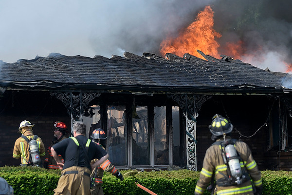 BEN MIKESELL | THE GOSHEN NEWS<br /> Firefighters take turn entering a burning house Tuesday morning at C.R. 42 in Millersburg. Benton, Turkey Creek and New Paris fire departments responded to assist Millersburg Clinton Fire Territory.
