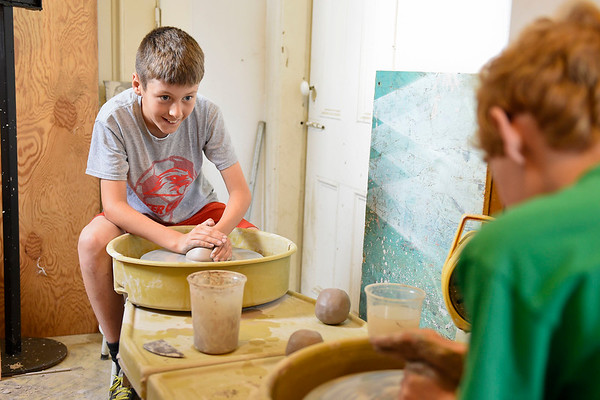 BEN MIKESELL | THE GOSHEN NEWS<br /> Josiah Eisenhour, 11, of Goshen, gets ready to spin clay during a class Monday at Goshen Youth Arts.