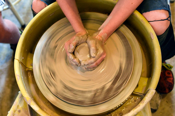 BEN MIKESELL | THE GOSHEN NEWS<br /> Cai Saner, 10, of Goshen, learns to spin clay to make a cup during a class Monday at Goshen Youth Arts.
