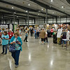 BEN MIKESELL | THE GOSHEN NEWS<br /> People walk down the row of vendors during the opening day of the event Wednesday afternoon at the Michiana Event Center in Shipshewana.
