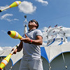 "BEN MIKESELL | THE GOSHEN NEWS<br /> Emiliano Fusco, a fifth-generation juggler from Brazil, practices his routine outside the Cirque Italia tent Wednesday afternoon at the Elkhart County 4-H Fairgrounds. The European-style circus uses 35,000 gallons of water to make a curtain around the stage area, which can be manipulated to make patterns, shapes and different colors during performances. No animals are used in this ""water circus,"" but instead features 11 performers from around the world, including Portugal, Argentina, Romania and Italy. The first of seven shows at the fairgrounds is today at 7:30 p.m. For tickets and showtimes this weekend, visit cirqueitalia.com"