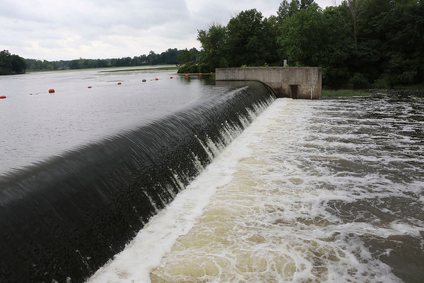 JOHN KLINE | THE GOSHEN NEWS<br /> Water flows over the Goshen Dam Monday afternoon. Goshen Board of Public Works and Safety members Monday authorized the funding of a $37,000 study aimed at exploring the potential use of the Goshen Dam Pond for flood control.