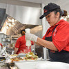 BEN MIKESELL | THE GOSHEN NEWS<br /> Ruth Hernandez, of Goshen, makes a torta in the kitchen Thursday morning at the new Tacos El Portal Express in Goshen.
