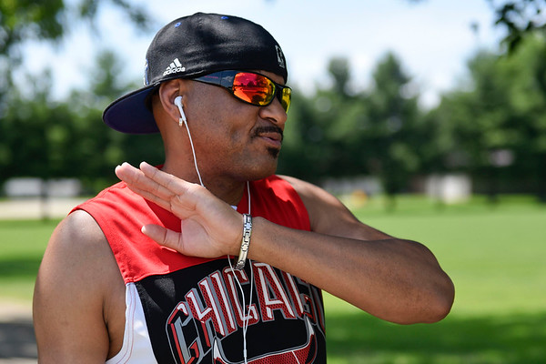 BEN MIKESELL | THE GOSHEN NEWS<br /> Geovanny Almiray, of Goshen, talks about his experiences as a refugee from Cuba while exercising Wednesday at Pringle Park in Goshen.
